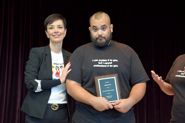 Abraham Cruz standing next to Dr. Melissa Chavez, UT-UCS Superintendent, at the summer convocation ceremony, where he received the Staff of the Year Award.