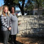 Administrators at The Settlement Home sign